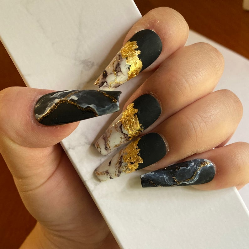 Matte black and marble nails with gold flakes