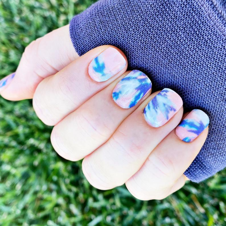 Short pink and blue tie dye nails