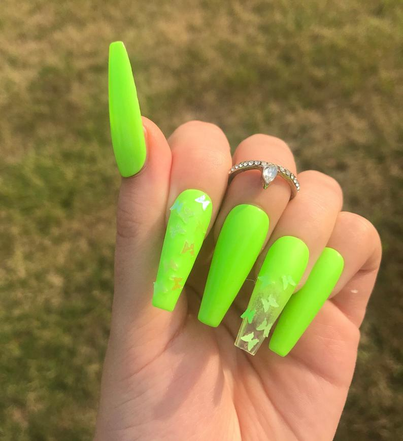 Neon green nails with butterflies