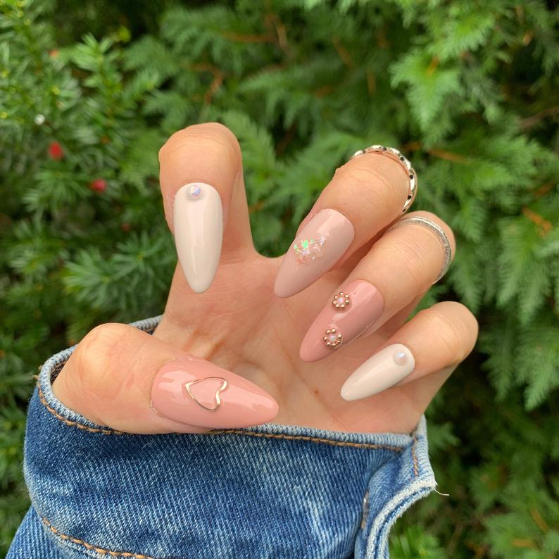 Nude almond nails with decals