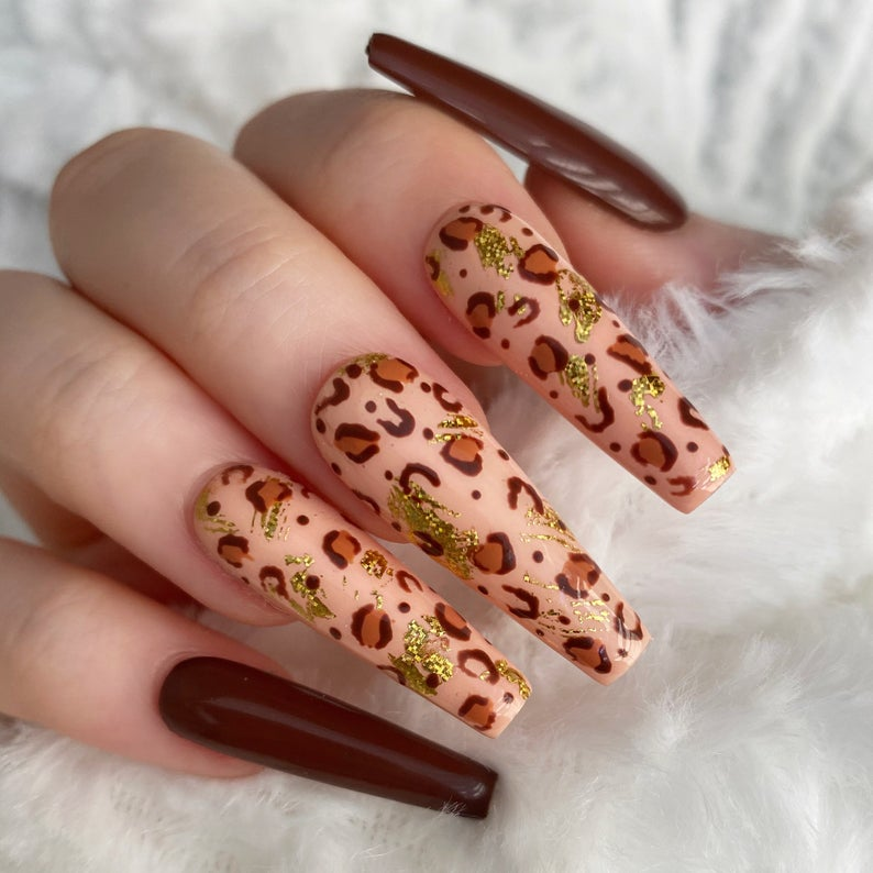 Brown leopard nails with gold specks