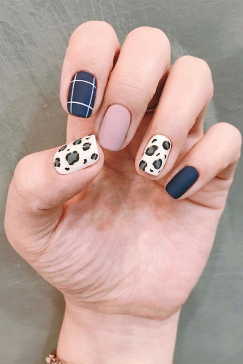 Matte leopard nails with navy blue print