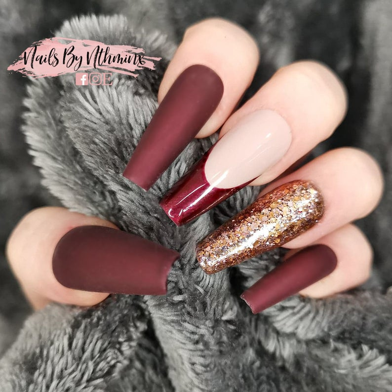 Matte burgundy nails with tip and gold glitter