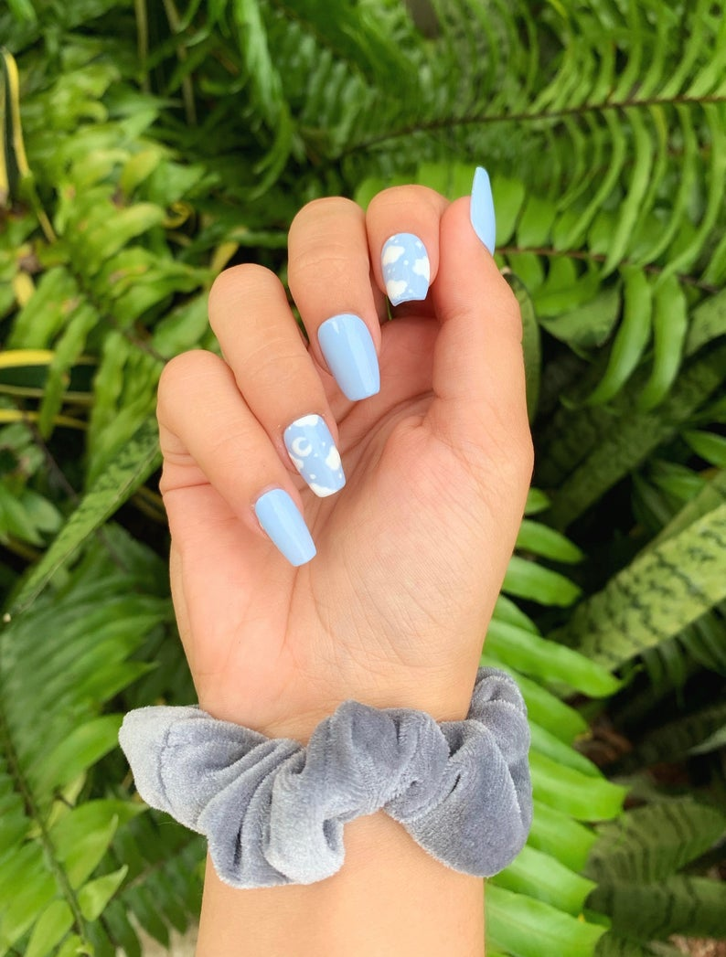 Clouds and blue nails