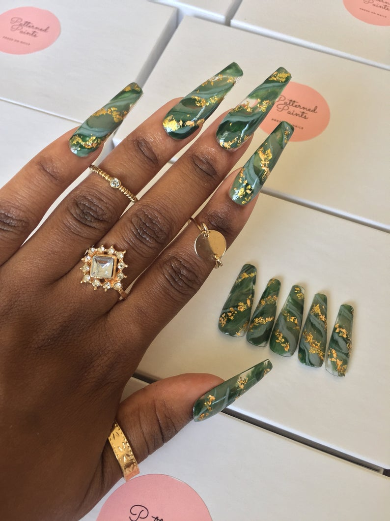 Marble green nails with gold specks