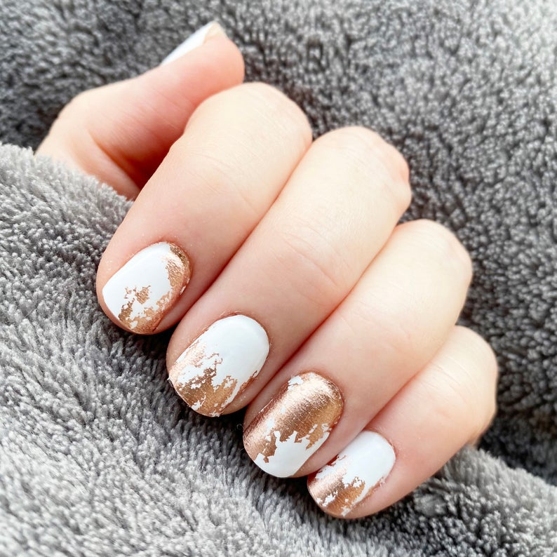 White matte nails with gold flakes