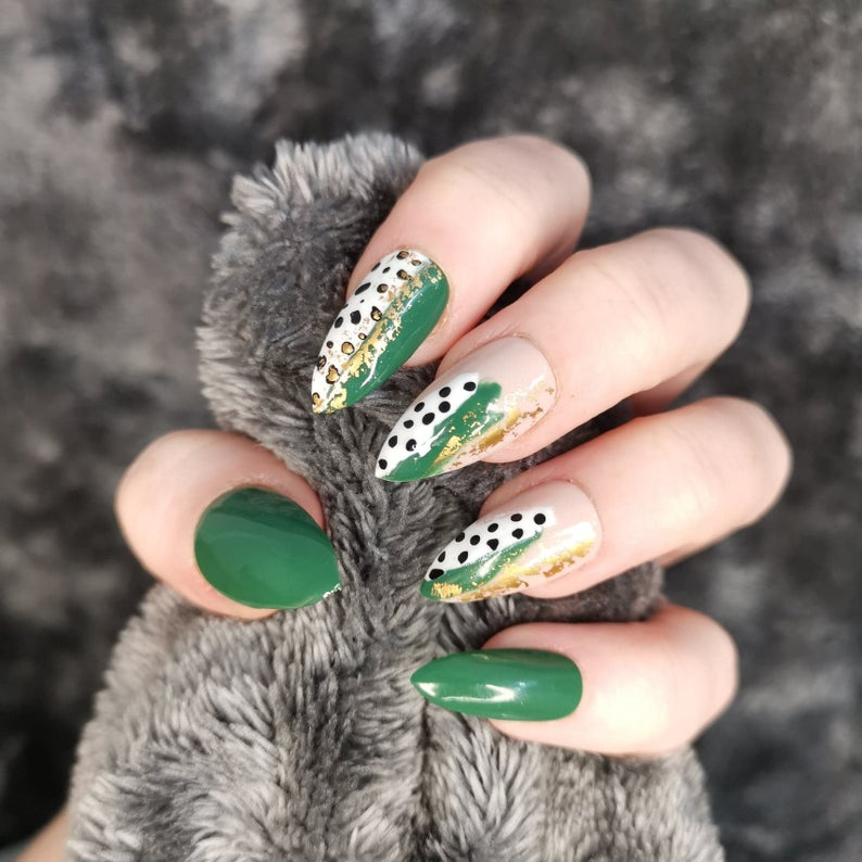 Green abstract nails with gold specks