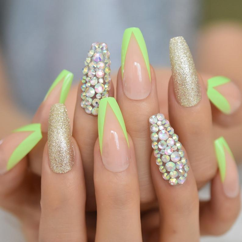Lime green French tip nails with rhinestones