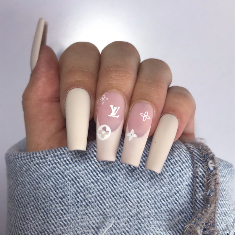 Nude nail design with LV logo