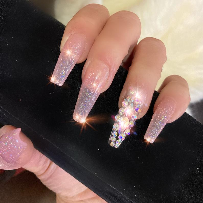 Transparent nails with glitter and rhinestones