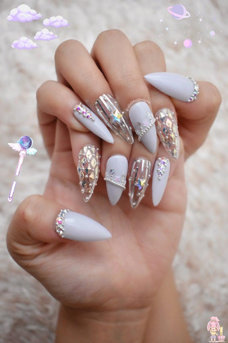 Pretty stiletto nails with rhinestones, sailor moon vibes