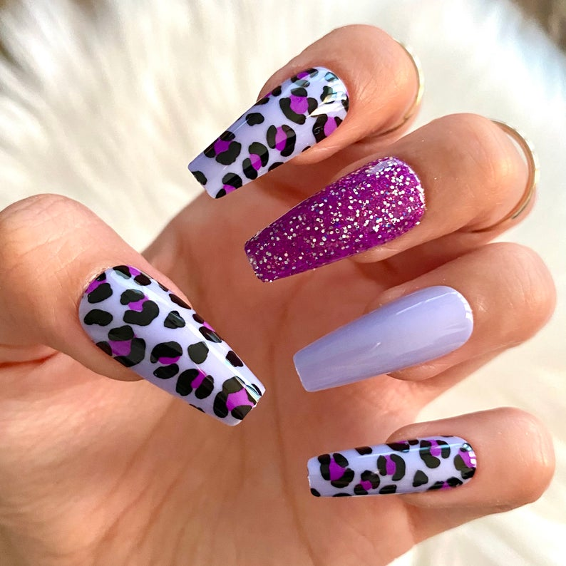 Purple leopard print and glitter design for coffin nails