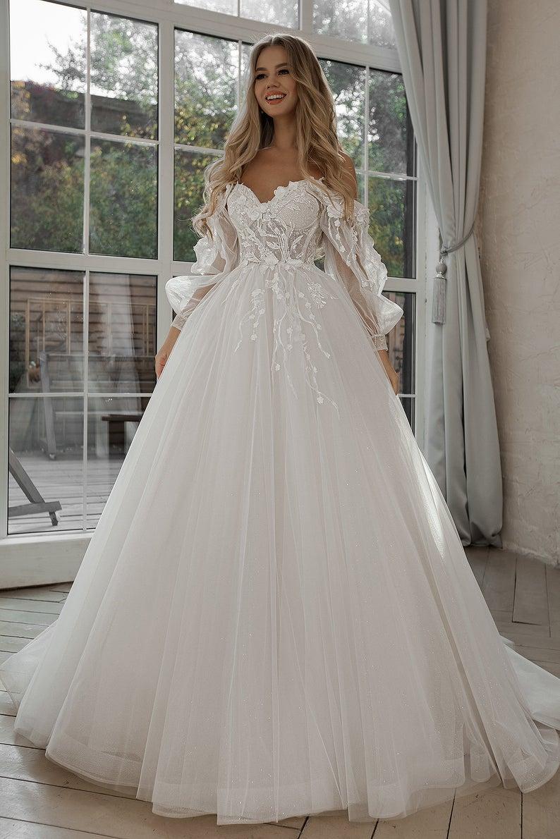 Whimsical off-shoulder affordable wedding dress