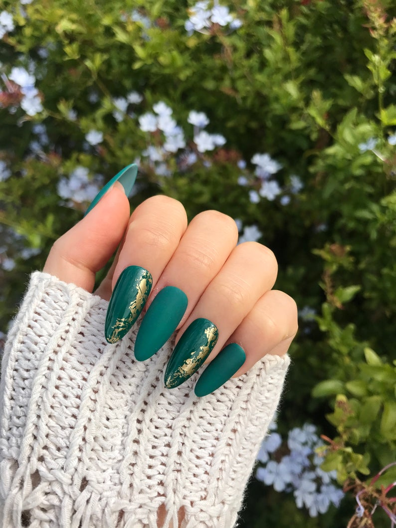 Emerald green nails with gold flakes