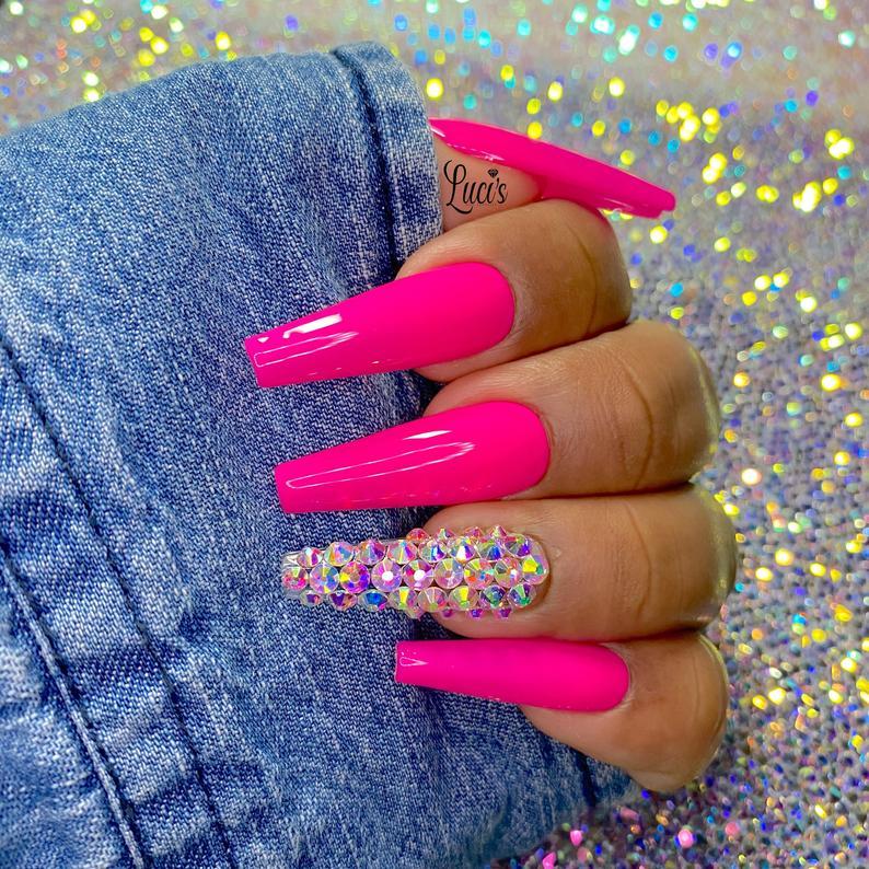 Neon pink gel nails with rhinestones