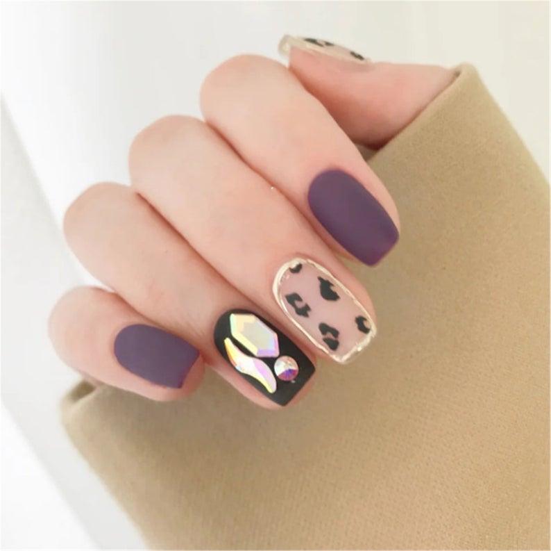 Matte purple leopard nails with rhinestones