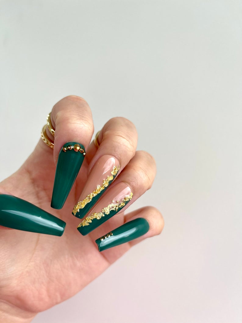 Jade green nails with gold accents