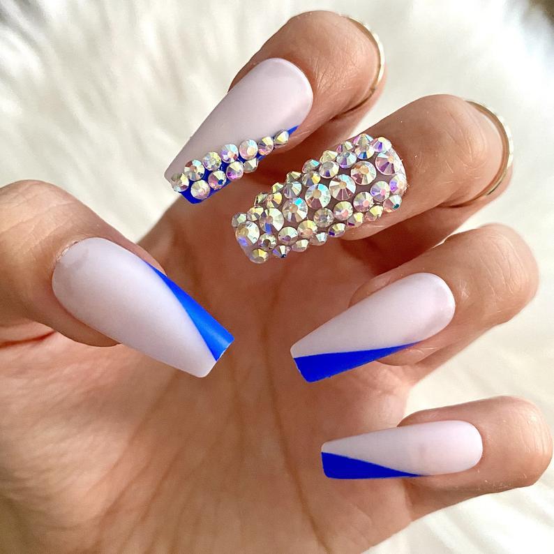 Blue and rhinestones nails