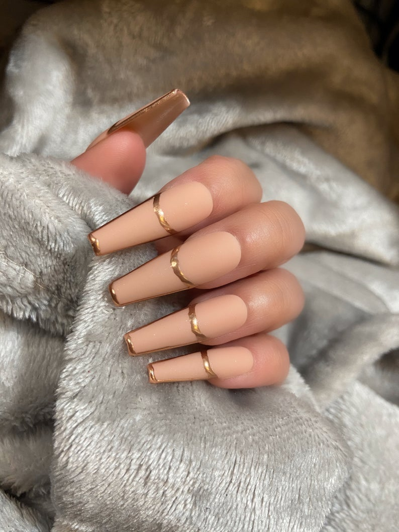 Nude matte nails with gold accents