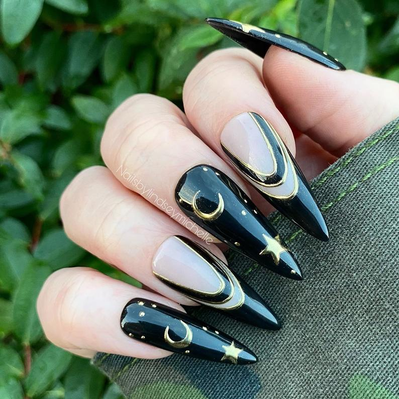 Black stiletto nails with crescent moon, goth and witch vibes