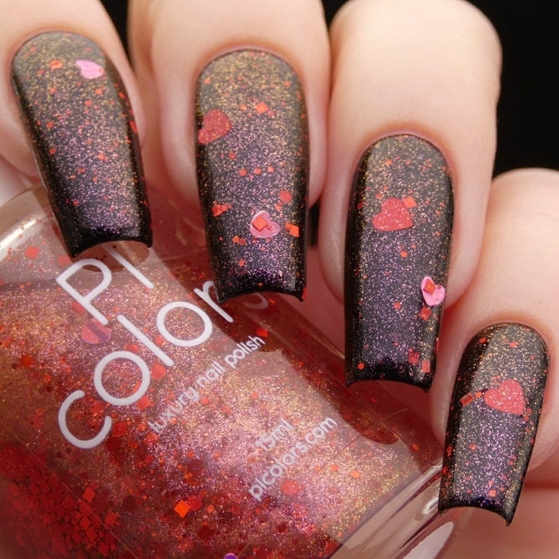 Black nails with red glitter