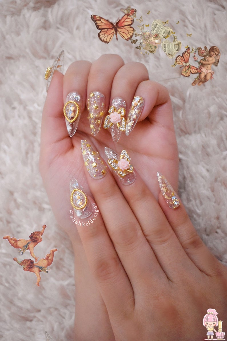 Holographic kawaii sailor moon nail art with 3D butterflies
