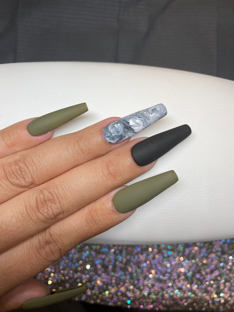 Matte green nails with marble designs