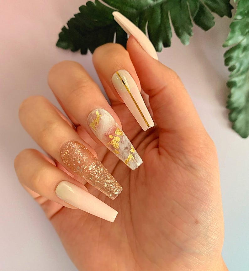Nude nail designs with gold accents