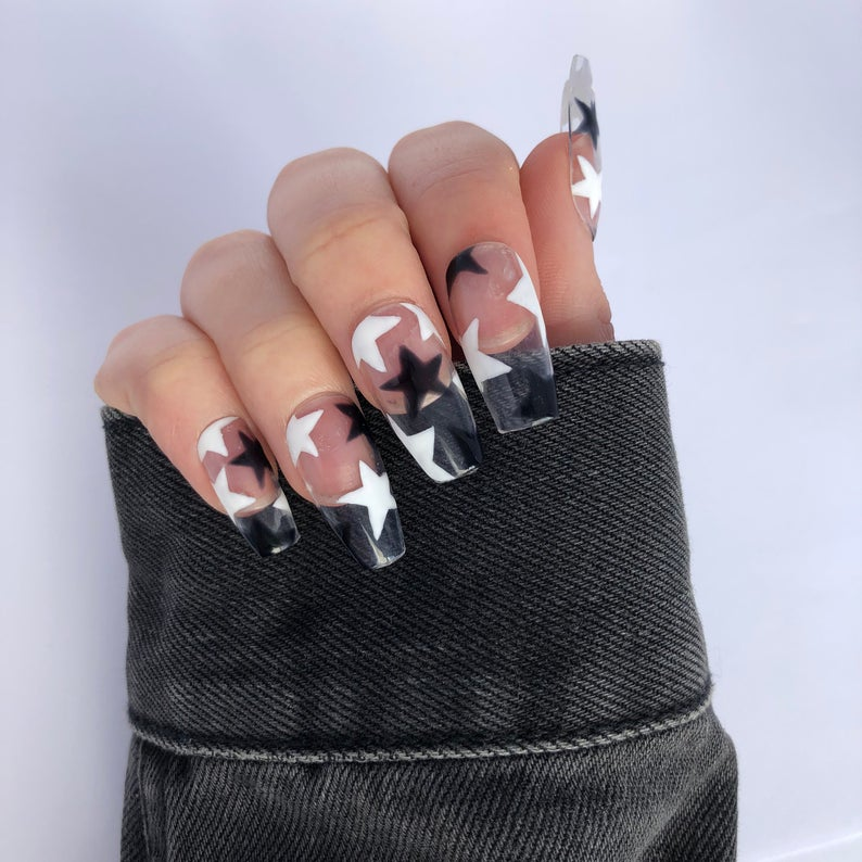 Clear nails with black and white stars