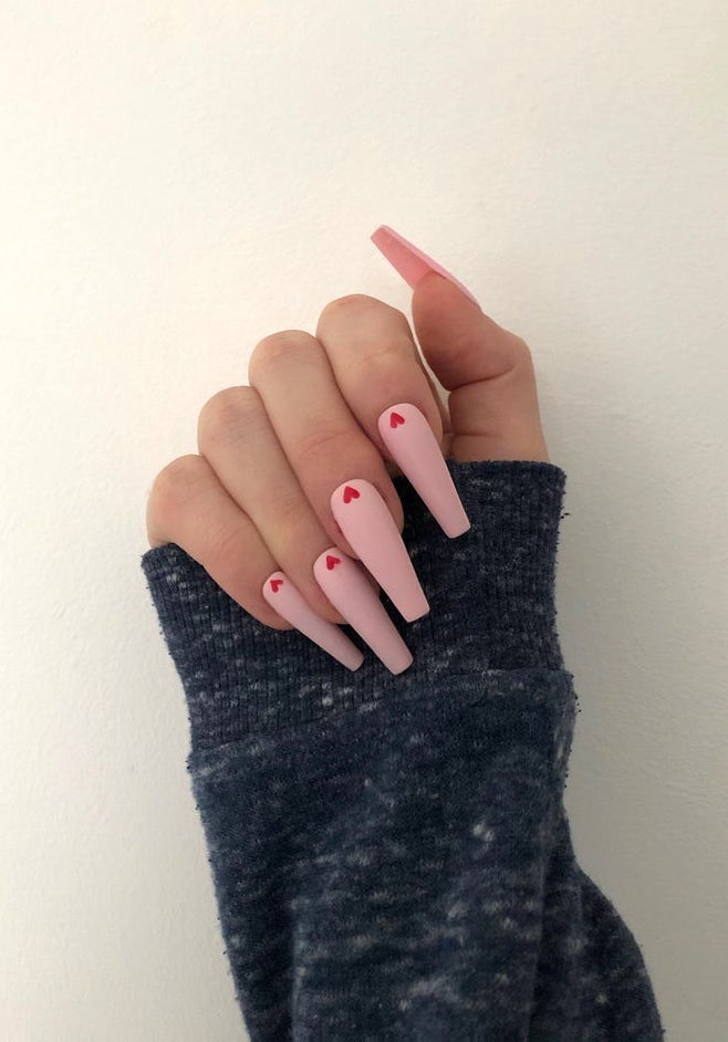 Soft pink matte nails with hearts