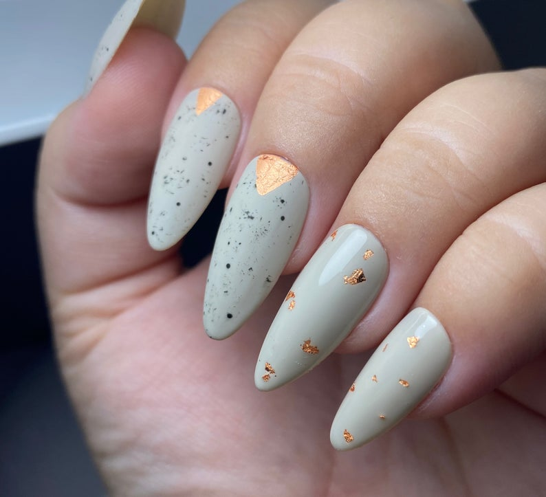 Light grey nails with gold specks