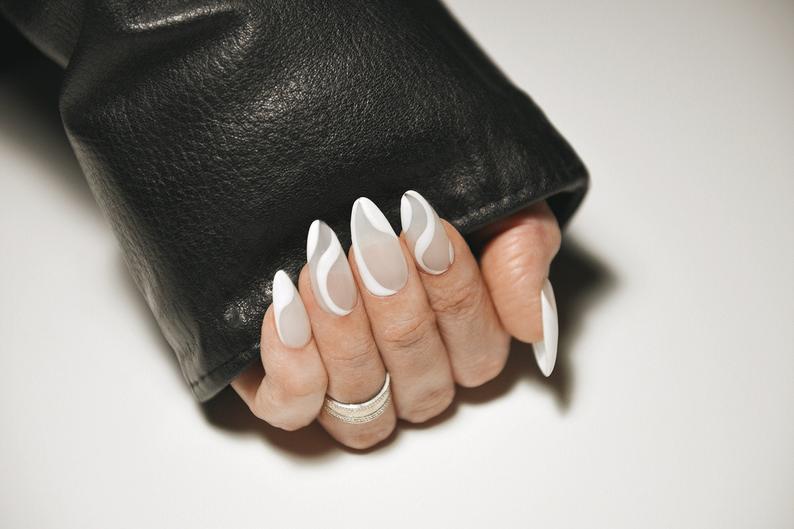 Grey and white wavy almond nail design
