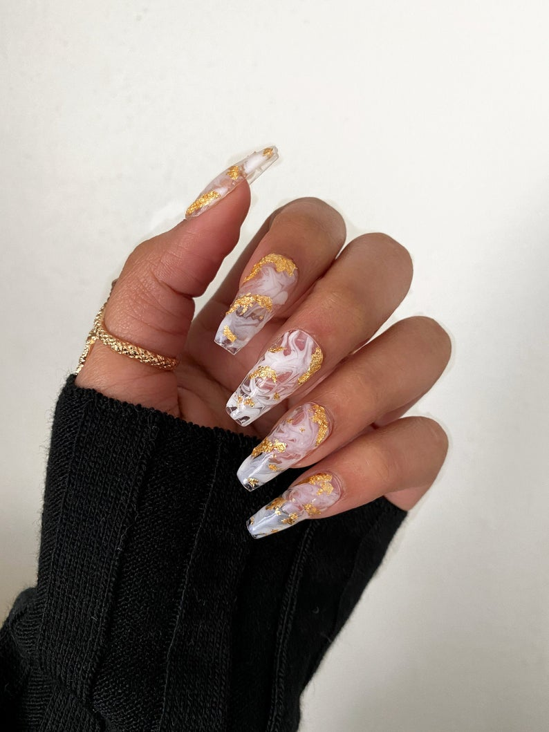 Transparent white nails with gold flakes