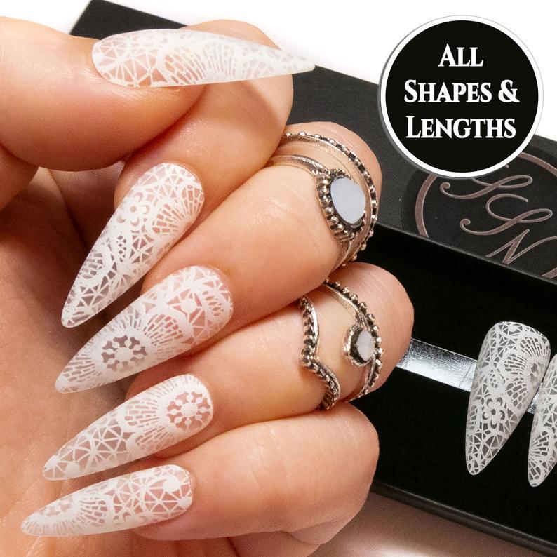 Stiletto nails with white lace design