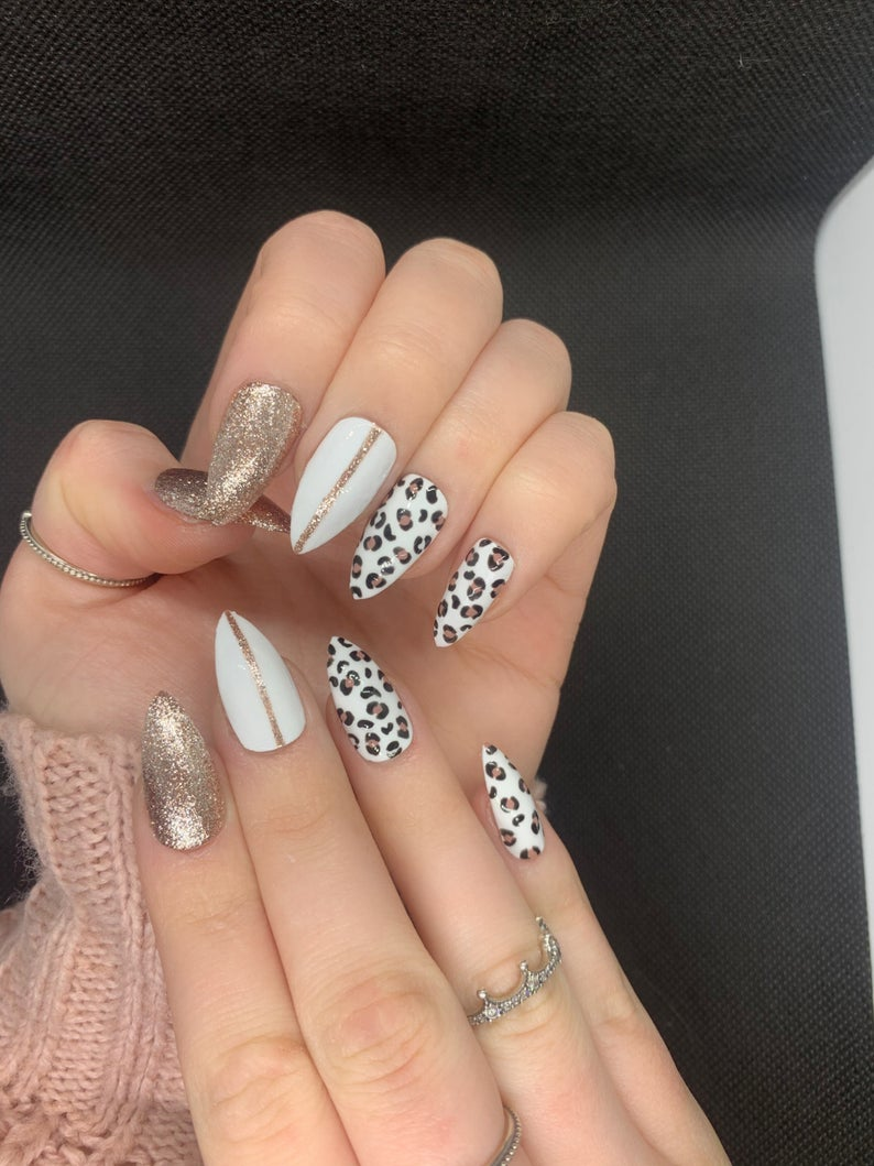 White leopard nails with gold glitter