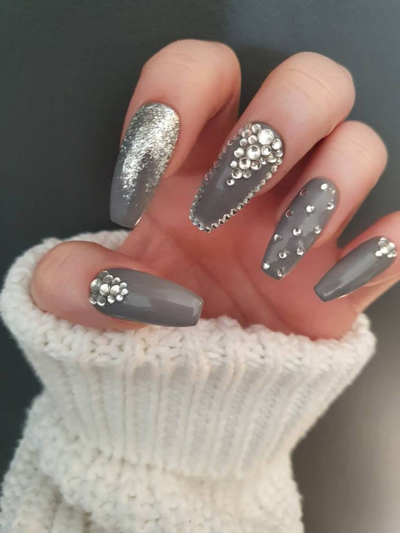 Grey nails with glitter and rhinestones