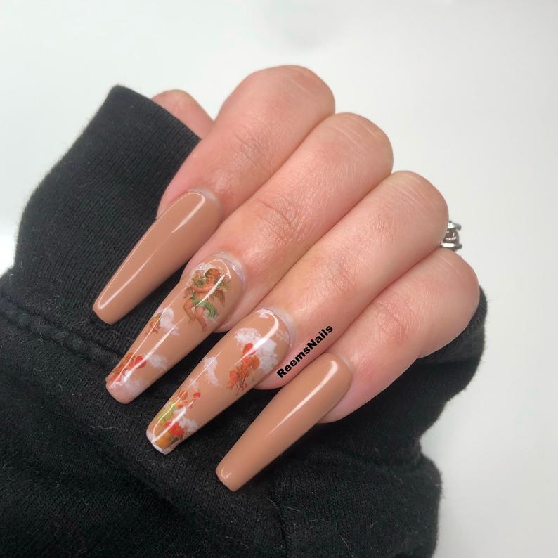 Nude nails with clouds and angels