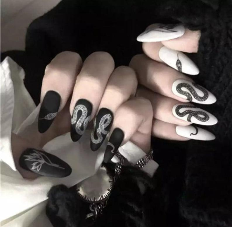 Black and white almond nail design with snakes