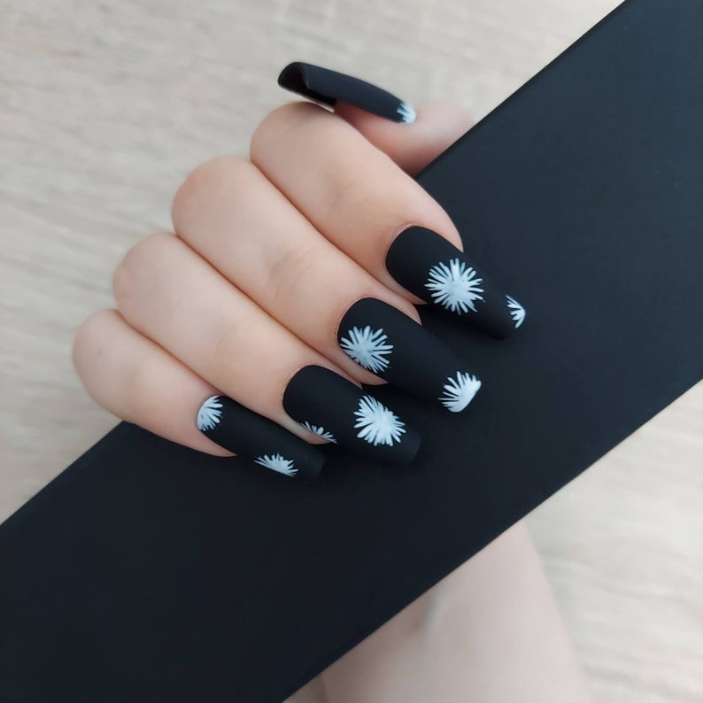 Black matte nails with white flowers