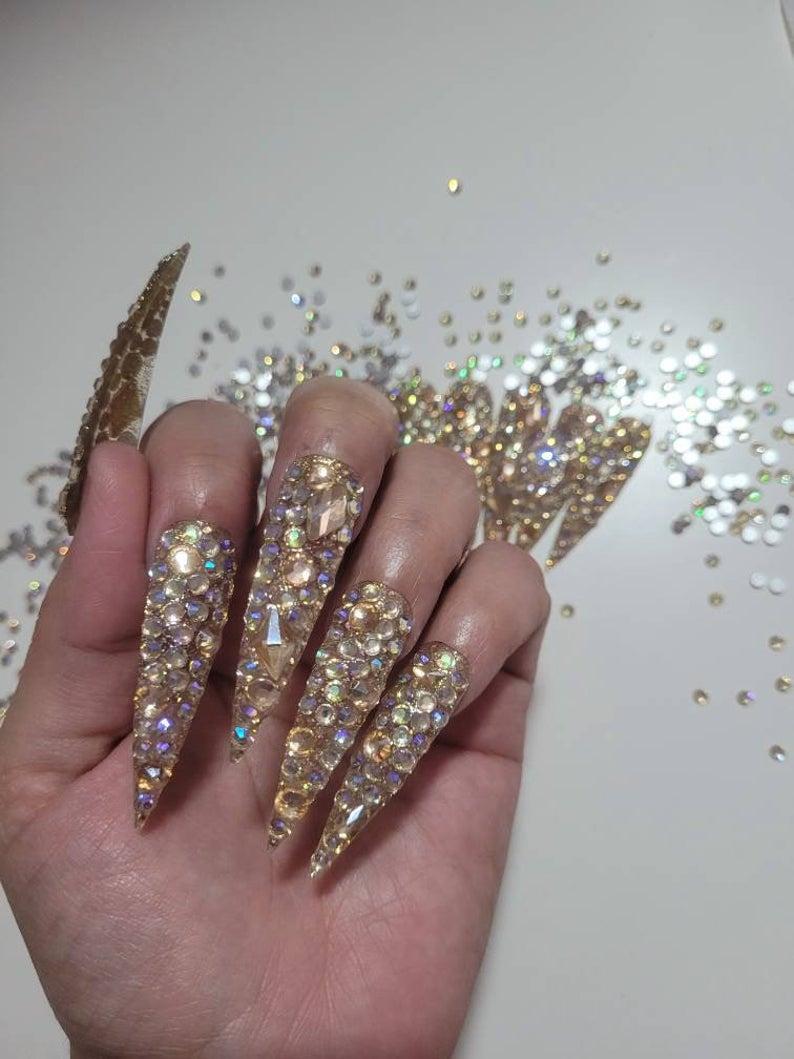 Stiletto nails with rhinestone design