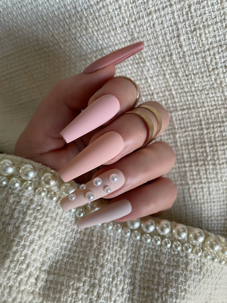 Pastel pink matte nails with pearls