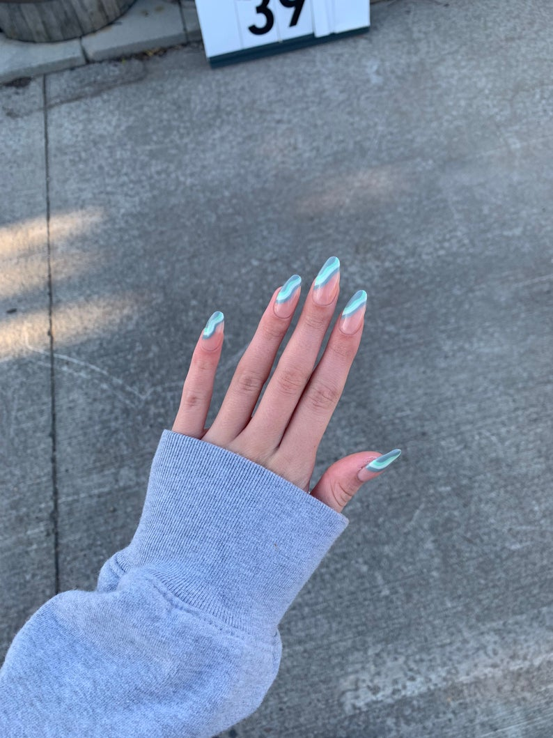 Almond nails with green and blue waves