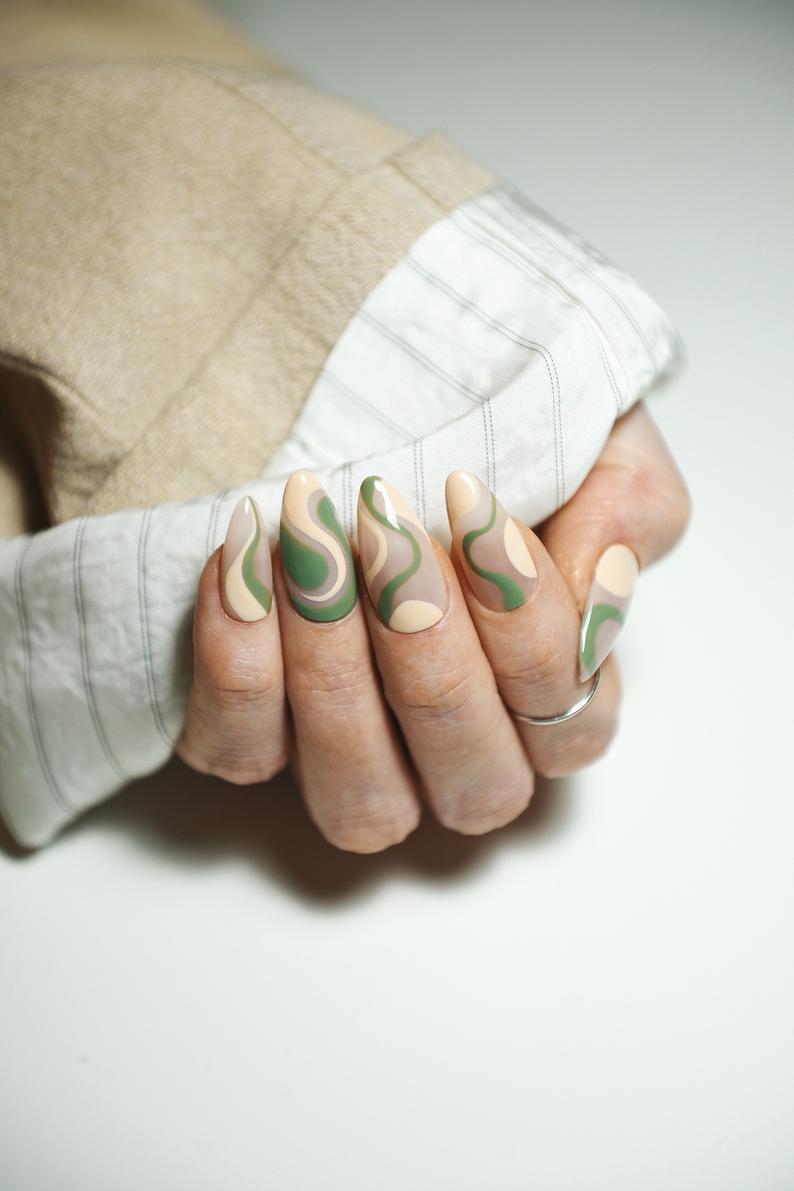 Green and cream almond nail design
