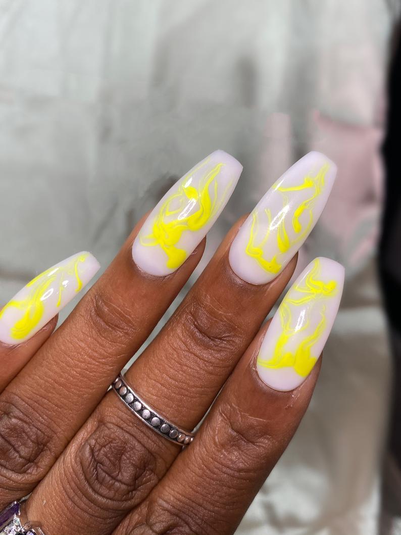 White and yellow swirly nails
