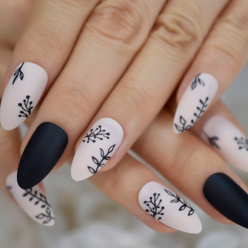 Black and white almond nails with flowers