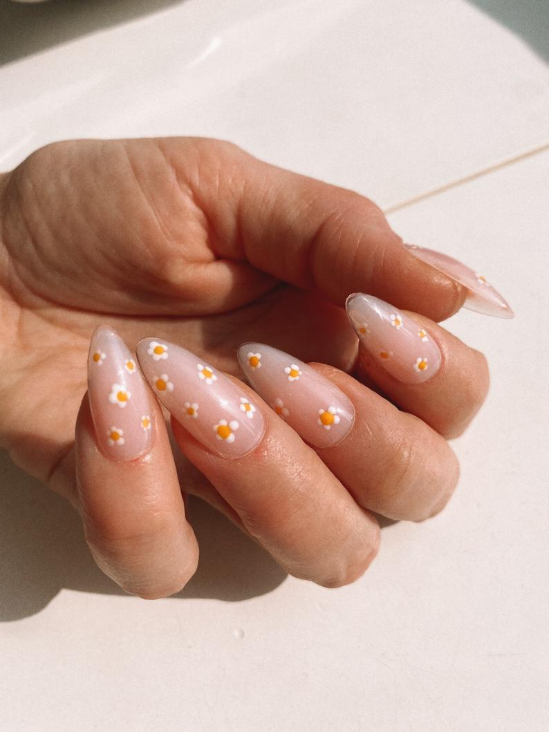 Nude almond nails with flowers
