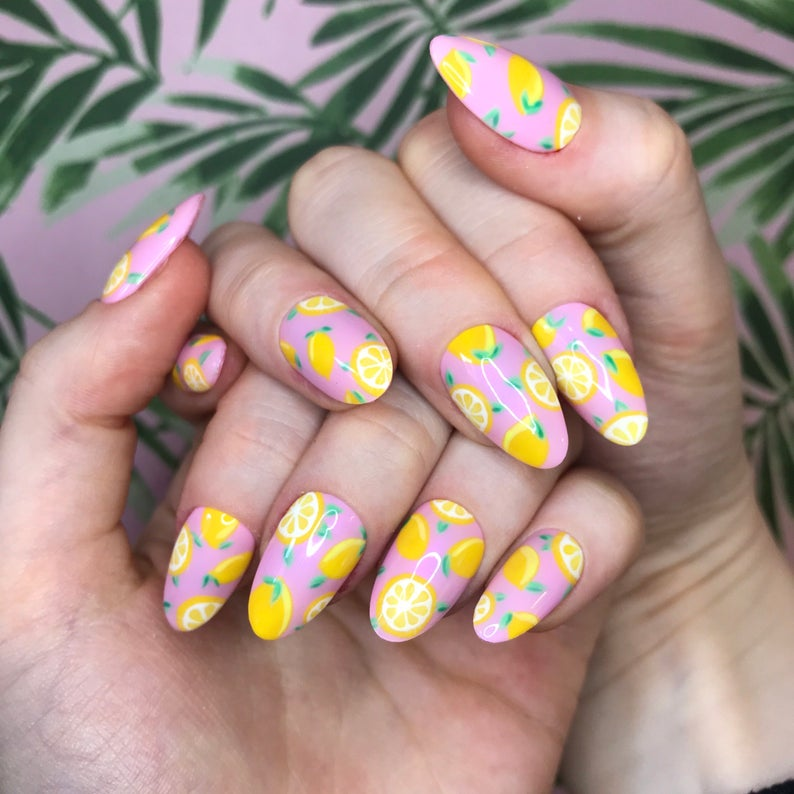 Pink almond nails with lemon design