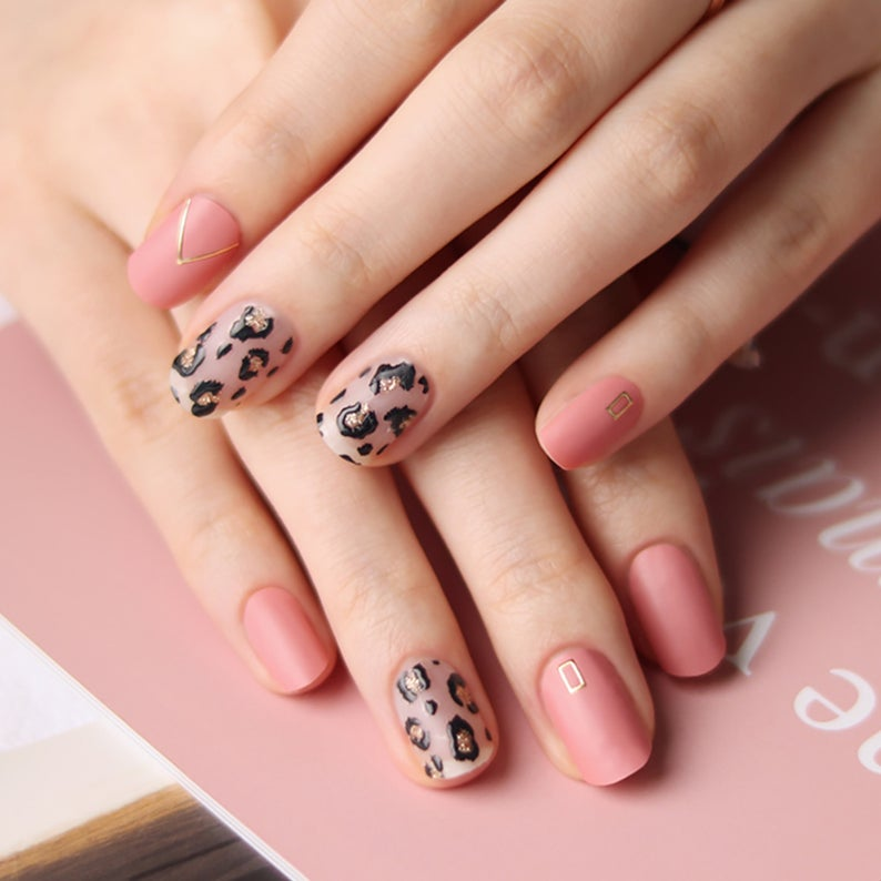 Soft pink leopard nails with gold accents