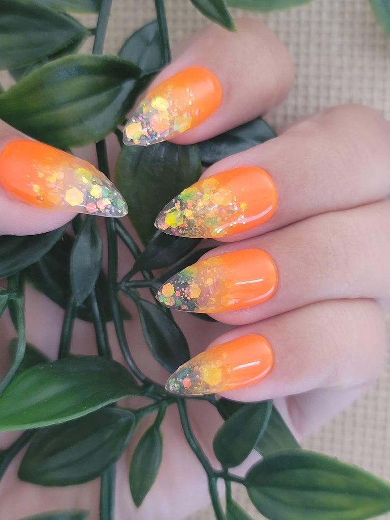 Neon orange ombre glitter nails