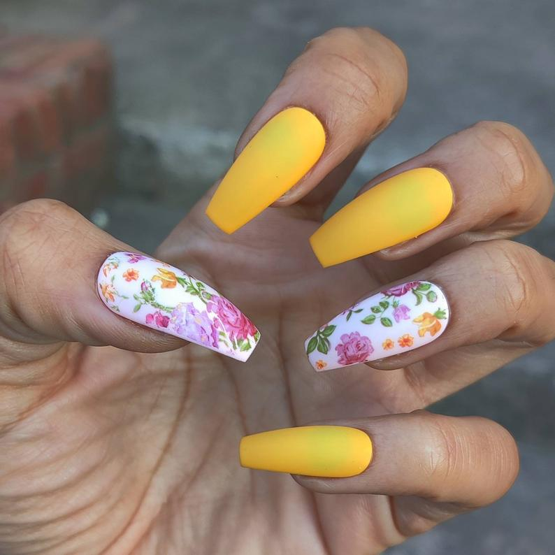 Matte yellow nails with floral design